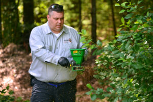 John Herbaly, Owner of Old School Pest Control knows the edge of wooded areas need tending to